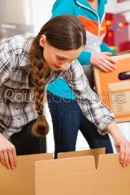 stock photo: two women with moving box in her house-Raw Stock Photo ID: 44147