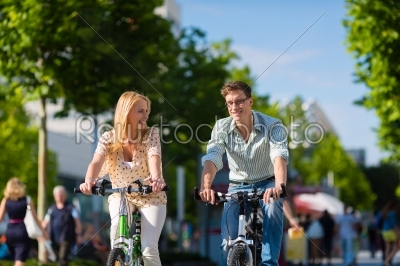 stock photo: urban couple riding bike in free time in city-Raw Stock Photo ID: 45918