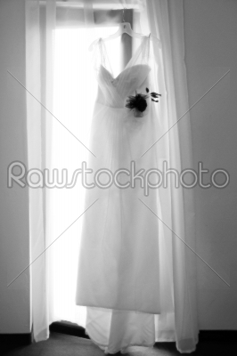 stock photo: white wedding dress hanging on a shoulders-Raw Stock Photo ID: 28392