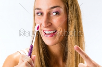 stock photo: woman brushing her teeth with toothbrush-Raw Stock Photo ID: 46389