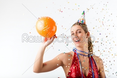 stock photo: woman celebrating birthday at a shower of confetti with balloon-Raw Stock Photo ID: 43794