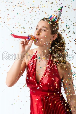 stock photo: woman celebrating birthday with streamer and party hat-Raw Stock Photo ID: 43826