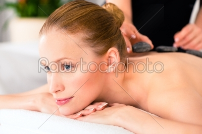 stock photo: woman having wellness spa hot stone massage-Raw Stock Photo ID: 38481