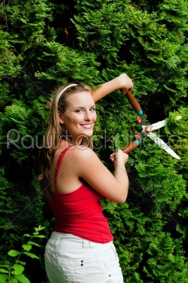 stock photo: woman in garden trimming hedge-Raw Stock Photo ID: 38946