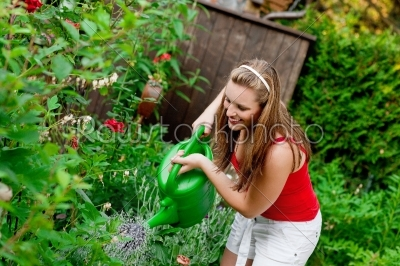 stock photo: woman in garden watering flowers-Raw Stock Photo ID: 38940