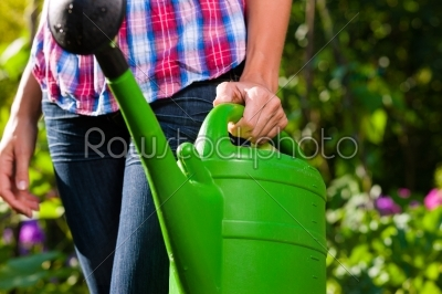 stock photo: woman in garden with watering can in hand-Raw Stock Photo ID: 42560