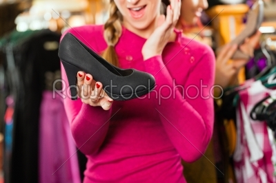 stock photo: woman is buying shoes for her tracht or dirndl in a shop-Raw Stock Photo ID: 43948