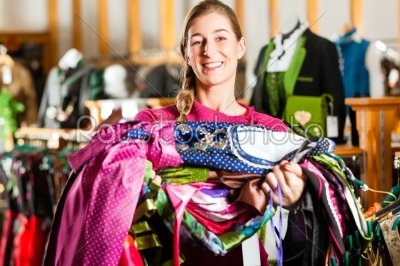 stock photo: woman is buying tracht or dirndl in a shop-Raw Stock Photo ID: 43941
