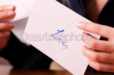 stock photo: woman is holding a love letter-Raw Stock Photo ID: 39306