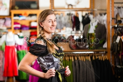 stock photo: woman is trying tracht or dirndl in a shop-Raw Stock Photo ID: 43952
