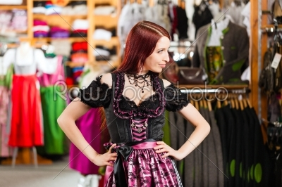 stock photo: woman is trying tracht or dirndl in a shop-Raw Stock Photo ID: 43954