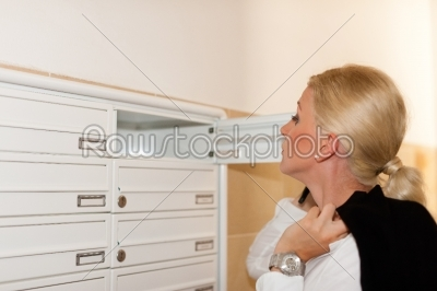 stock photo: woman looking after mail in letter box-Raw Stock Photo ID: 42563