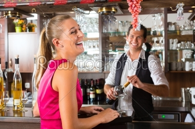 stock photo: woman ordering glass of wine at bar-Raw Stock Photo ID: 46397