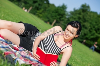 stock photo: woman reading book on meadow-Raw Stock Photo ID: 38978