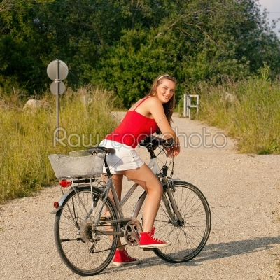 stock photo: woman riding her bicycle in summer-Raw Stock Photo ID: 38950