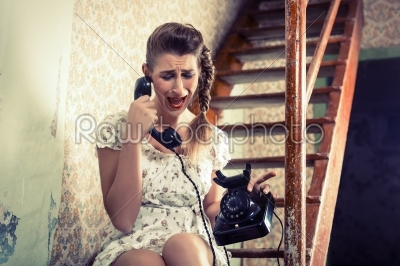 stock photo: woman sitting on the stairs and crying on the phone-Raw Stock Photo ID: 44907