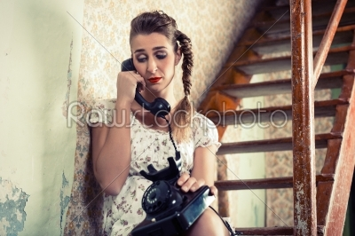 stock photo: woman sitting on the stairs and crying on the phone-Raw Stock Photo ID: 44908