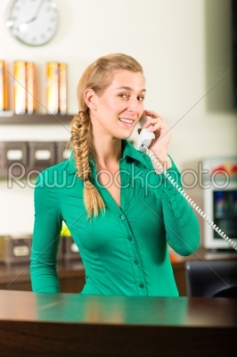 stock photo: woman taking a call at gym reception-Raw Stock Photo ID: 45521