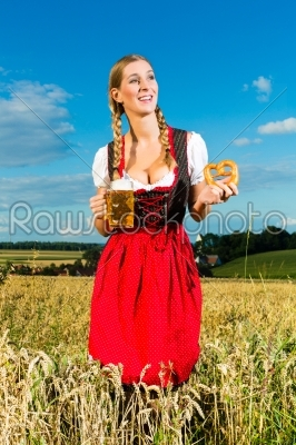 stock photo: woman with tracht beer and pretzel in bavaria-Raw Stock Photo ID: 46010