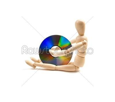 stock photo: wood mannequin with cdrom-Raw Stock Photo ID: 30806