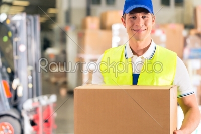stock photo: worker holds package in warehouse of forwarding-Raw Stock Photo ID: 47013