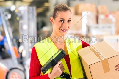 stock photo: worker scans package in warehouse of forwarding-Raw Stock Photo ID: 47012