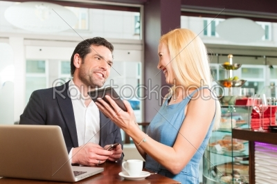 stock photo: working colleagues  a man and a woman  sitting in cafe-Raw Stock Photo ID: 44459