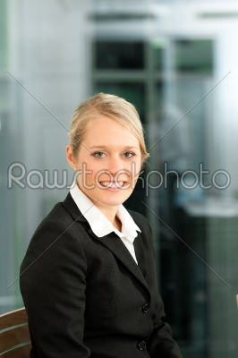 stock photo: young businesswoman in her office-Raw Stock Photo ID: 42780