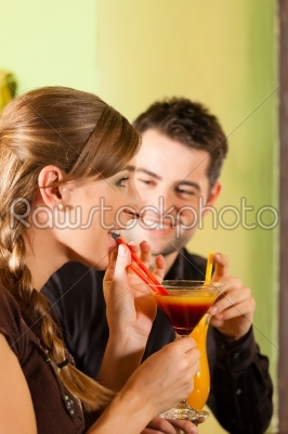 stock photo: young couple drinking cocktails in bar or restaurant-Raw Stock Photo ID: 44361