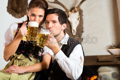 stock photo: young couple in a hunters cabin-Raw Stock Photo ID: 48296
