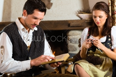 stock photo: young couple in mountain hut at fire place-Raw Stock Photo ID: 48288