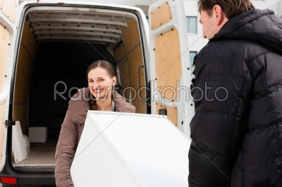 stock photo: young couple loading a moving truck-Raw Stock Photo ID: 44142