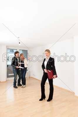 stock photo: young couple looking for real estate with female realtor-Raw Stock Photo ID: 43402