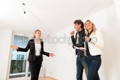 stock photo: young couple looking for real estate with female realtor-Raw Stock Photo ID: 43405