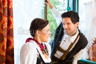 stock photo: young couple on the window of a hunters cabin-Raw Stock Photo ID: 48314
