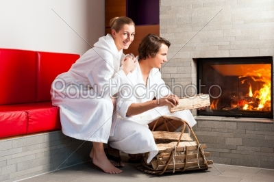 stock photo: young couple sitting in bathrobe for open fireplace-Raw Stock Photo ID: 43728