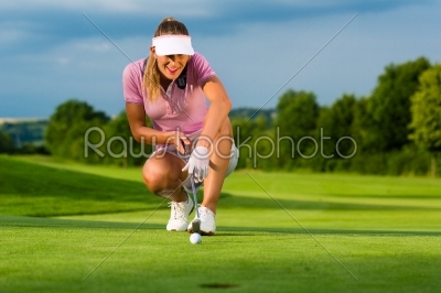 stock photo: young female golf player on course aiming for her put-Raw Stock Photo ID: 45915
