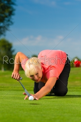 stock photo: young female golf player on course aiming for put-Raw Stock Photo ID: 46106