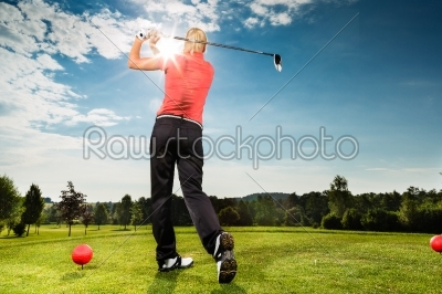 stock photo: young golf player on course doing golf swing-Raw Stock Photo ID: 46088