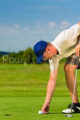 stock photo: young golf player on course putting-Raw Stock Photo ID: 46108