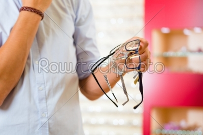 stock photo: young man at optician with glasses-Raw Stock Photo ID: 45766