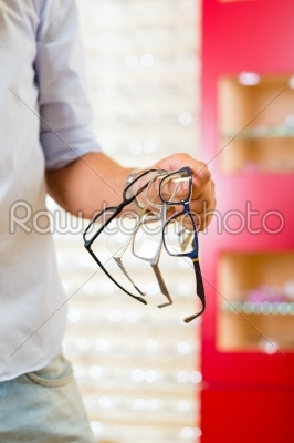 stock photo: young man at optician with glasses-Raw Stock Photo ID: 45767