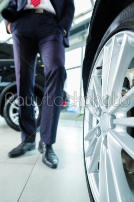 stock photo: young man or auto dealer in car dealership-Raw Stock Photo ID: 38668