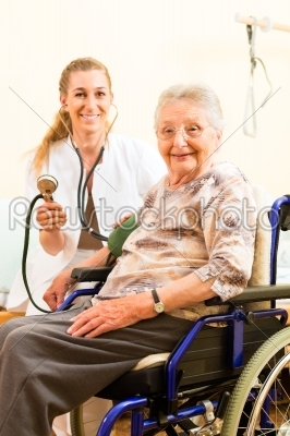 stock photo: young nurse and female senior in nursing home-Raw Stock Photo ID: 45164