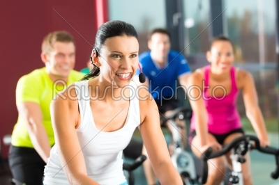 stock photo: young people  group of women and men  doing sport spinning in the gym for fitness-Raw Stock Photo ID: 47158
