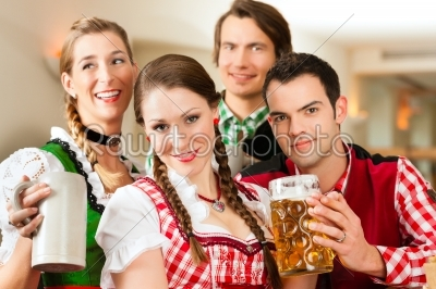 stock photo: young people in traditional bavarian tracht in restaurant or pub-Raw Stock Photo ID: 44007