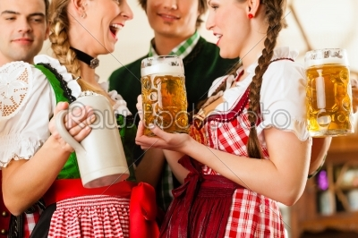 stock photo: young people in traditional bavarian tracht in restaurant or pub-Raw Stock Photo ID: 44051