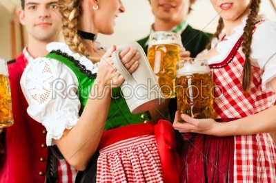 stock photo: young people in traditional bavarian tracht in restaurant or pub-Raw Stock Photo ID: 44052