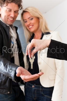 stock photo: young realtor is with keys in an apartment-Raw Stock Photo ID: 43419