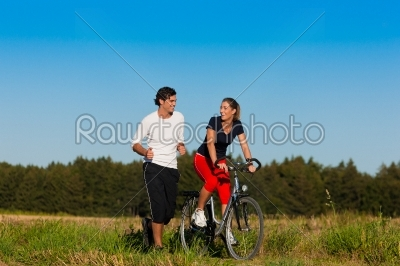 stock photo: young sport couple jogging and cycling -Raw Stock Photo ID: 39161